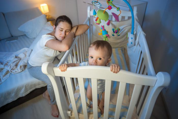 a-mother-sleeping-on-a-childs-crib